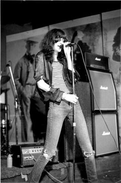 Joey Ramone onstage at CBGB, 1977.