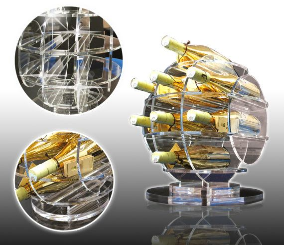 Little Sphere (cod. SPP08)  Lasered plexiglass winerack, consists of snap sections and representing a sphere of more compartments. May contain up to 8 bottles. For more info, please contact me.