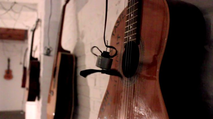 Enter a Hall of 40 Acoustic Guitars Played by Motors | The Creators Project