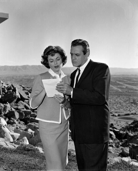 Actor Raymond Burr as Perry Mason examines a piece of paper with actress Barbara Hale as Della Street in an episode of the TV series 'Perry Mason'...