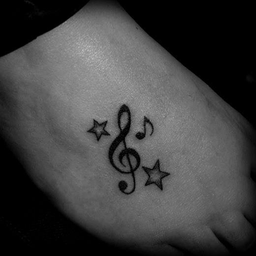 Tatuajes musicales de todos los tipos y estilos incluyendo claves y notas, cantantes e instrumentos de música