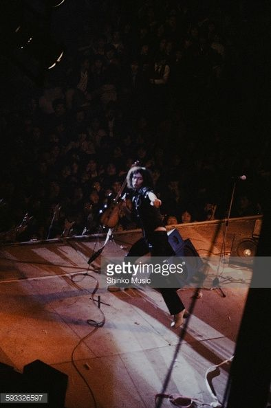 Rainbow Ritchie Blackmore wrecking guitar on stage at Nippon Budokan Tokyo…