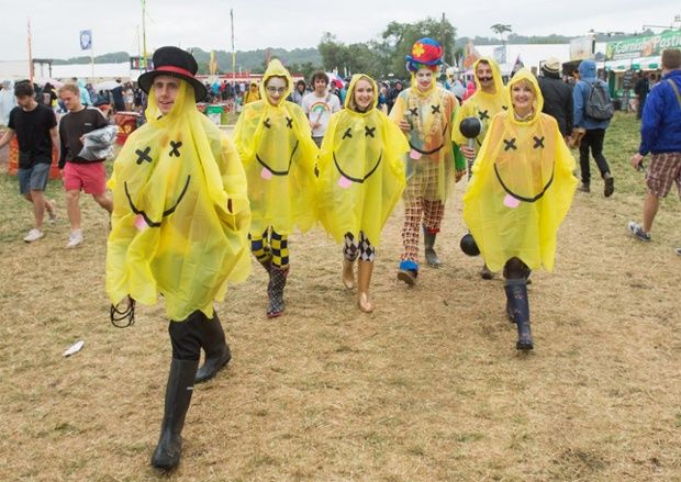 Glastonbury Festival goers walk in the rain 2014.