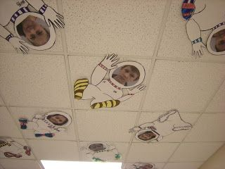 Astronauts on the ceiling with kids' photo faces! Love this idea for a space themed bulletin board!