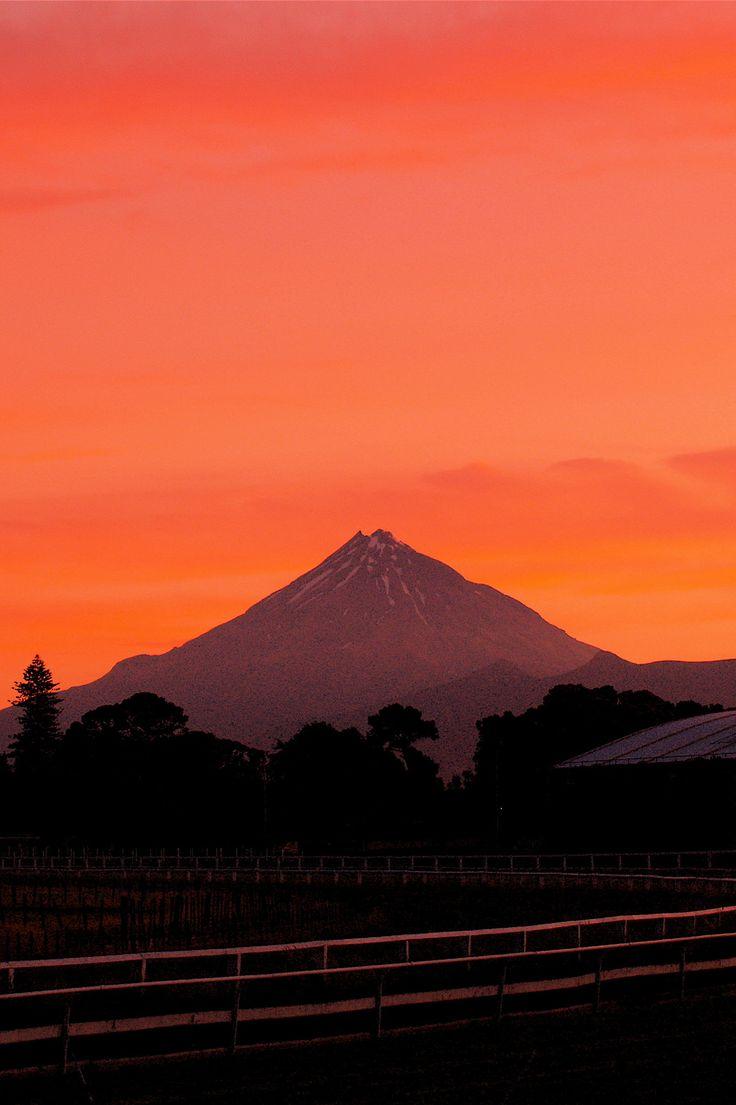 Taranaki volcano at sunset from the racecourse in New Plymouth, New Zealand.