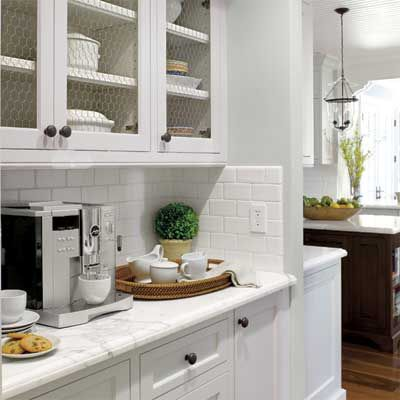 the butler's pantry in this remodeled, light-filled colonial home
