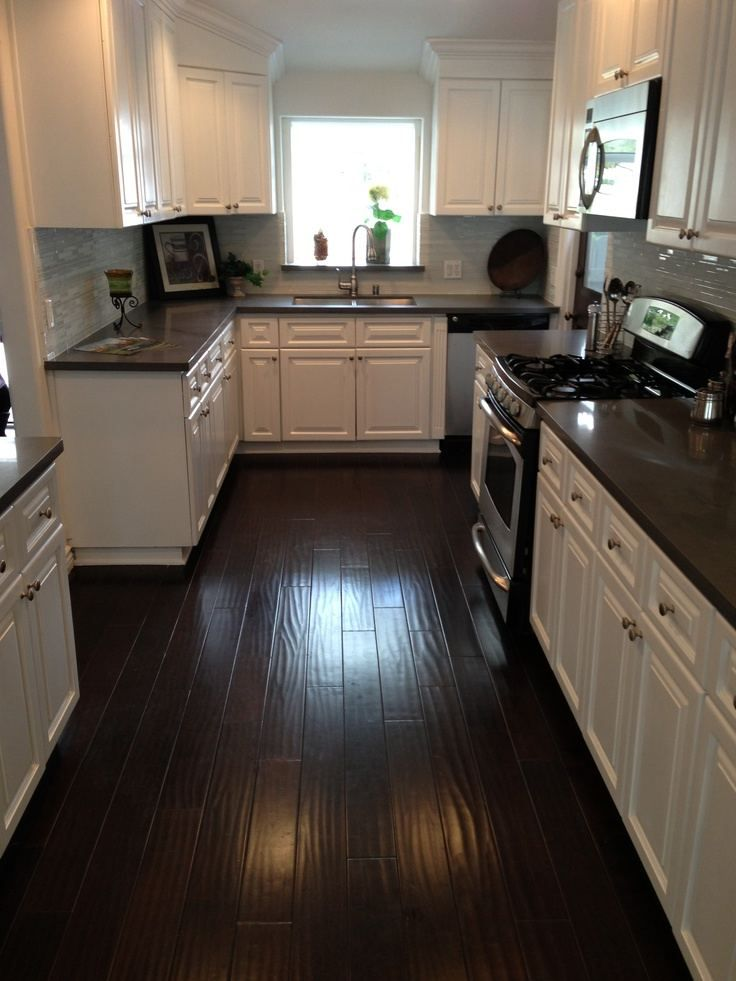 Kitchen With Grey Wood Floors And Brown Wood Floors Wood Floor Kitchen Dark Brown Kitchen Cabinets Kitchen Flooring