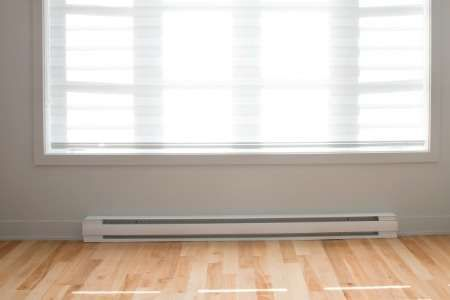 Factory finish baseboard heaters should be scuffed with a fine (120 or finer) grade sandpaper, wiped clean and treated with a liquid deglosser before priming