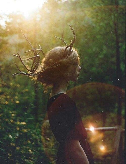 Deer antlers, woman
