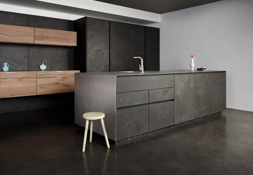 Dramatic dark modern kitchen cabinets. Love the idea of having a floating accent piece!