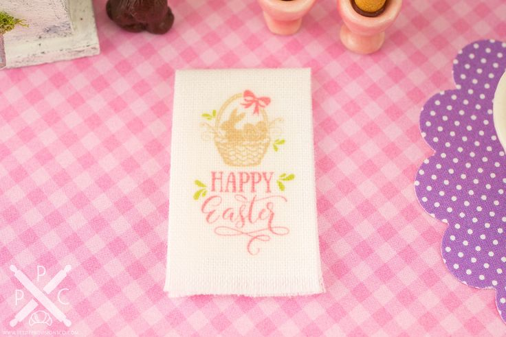 Decorate your mini kitchen and celebrate Easter with this darling little tea towel! This is a white tea towel featuring a silhouette of an Easter basket. Whether you have a dollhouse or just love all things tiny, this wee kitchen decoration is too cute to resist!
