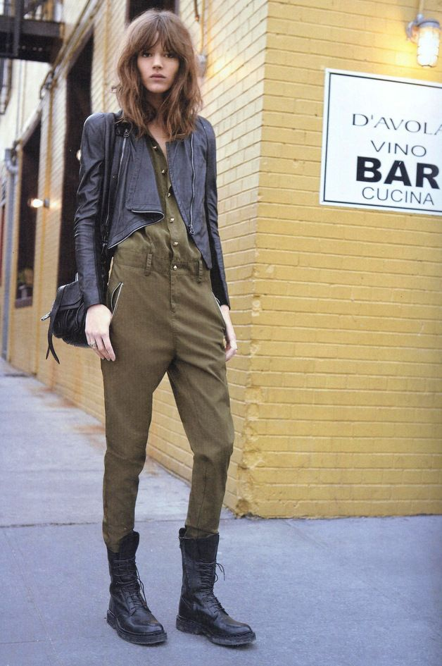 Freja Beha Erichsen does utilitarian dressing in an olive green jumpsuit and leather accessories