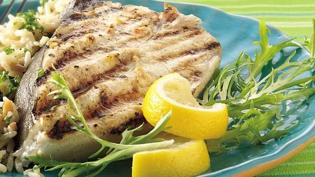 ... with fresh lemon creates a zesty marinade for grilled halibut steaks