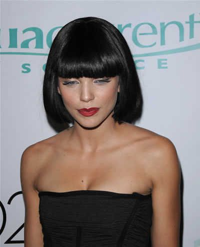 I have always wished I could rock really dark hair and bangs like this