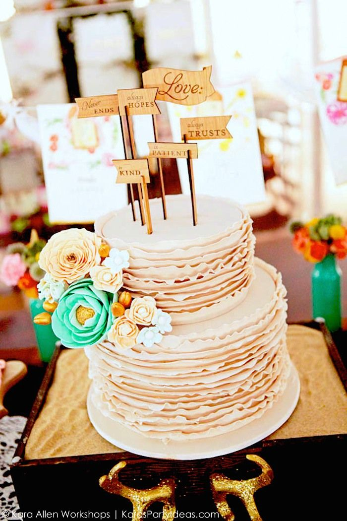 Amazing ruffle cake with wooden toppers! Boho bridal shower | wedding via Kara Allen, Kara's Party Ideas | KarasPartyIdeas.com Awesome bohemian, tribal, aztec, teepee, and rustic accents! Gorgeous dessert table!
