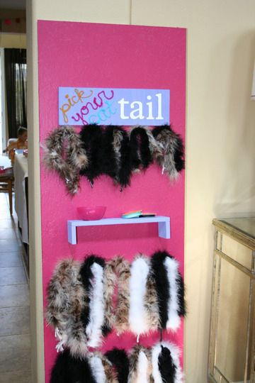 """Pick Your Tail"" party favors at a cat-themed party"