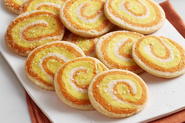 Get in the Halloween spirit with tasty Pinwheel Candy Corn Cookies! Kids won't be scared by these pinwheel cookies, but they'll definitely enjoy them.