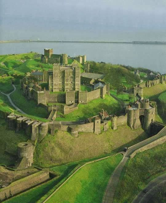 """Dover Castle is a medieval castle in the town of the same name in the English county of Kent. It was founded in the 12th century and has been described as the """"Key to England"""" due to its defensive significance throughout history. It is the largest castle in England."""