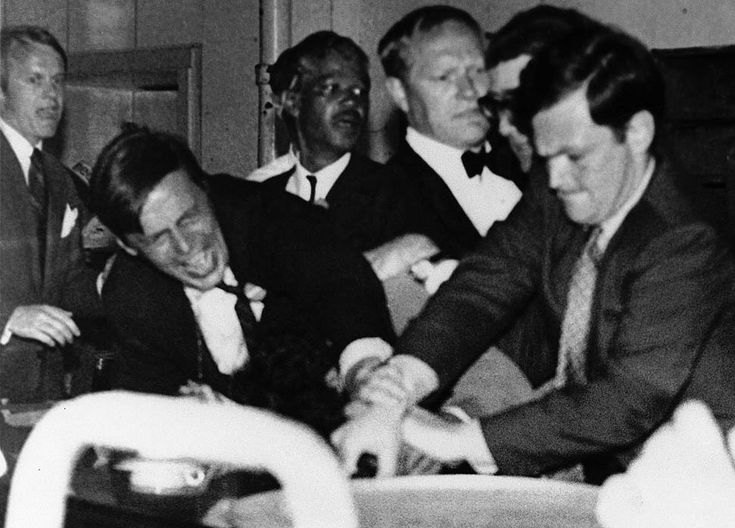 LOS ANGELES / KOREATOWN:  THE AMBASSADOR HOTEL.  Author George Plimpton, front left, and J.W. Gallivan, Jr., a Robert Kennedy aide, try to wrestle the pistol out of the hand of Sirhan Sirhan, who had just fired the fatal shots at presidential hopeful Sen. Robert Kennedy in the kitchen of the Ambassador Hotel in Los Angeles, June 5, 1968