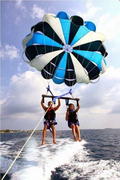 Royal Island Resort & Spa - Maldives. I want to do this with James. I love Parasailing.