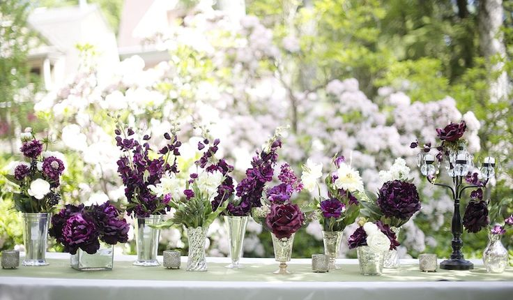 Very cute- get glass vases from the dollar store, antique shops, Gma's garage sale, etc and line up in front of appetizer table, next to placement cards, or even on reception tables