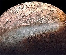 Triton is the largest moon of the planet Neptune, Triton's bright south polar cap above a region of cantaloupe terrain
