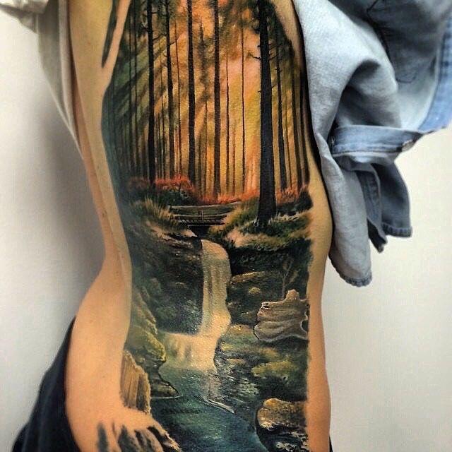 Amazing artist Jesse Rix @jesse_rix awesome color realism forest landscape lower side ribs tattoo! #jesserix #grande #land #fire #sun #shine #dream #forest #side #fun #inked #ink #tattoos #tattoo #cali #ribs #tree #color #3d #h2o #sullenclothing #nature #landscape #art #artwork #trees #europe  #photorealism #realism #creek