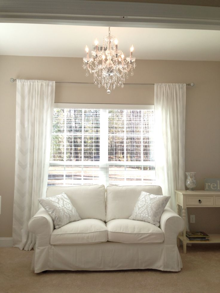 My sunroom reveal! Love the Ikea Ektorp loveseat, and Maria Teresa chandelier from Home Depot.