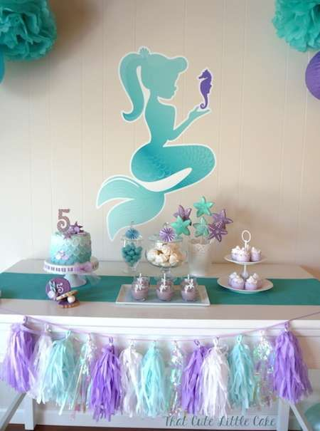 Pretty dessert table at a mermaid birthday party!  See more party planning ideas at CatchMyParty.com!