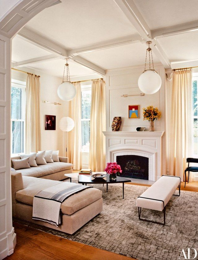 The family room's Isamu Noguchi floor lamp echoes the Jonathan Browning Studios pendant lights | archdigest.com