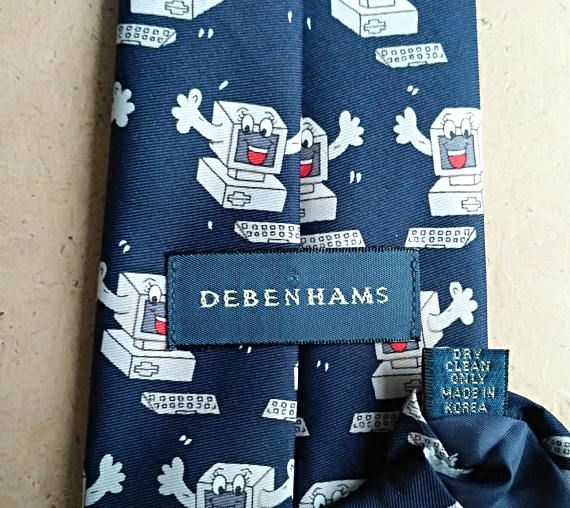 Vintage DEBENHAMS funny computers tie printed on blue background. Includes funny computers. This tie will be a good addition to the collection or a stylish accessory.  MATERIALS: 100% polyester LABEL: DEBENHAMS made in Korea MEASUREMENTS: Width - 10cm (4) - (widest part) Length - 141cm