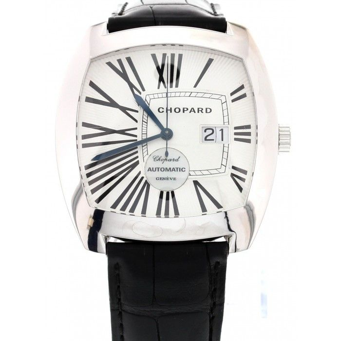 Beautiful & Rare 18k White Gold Chopard Classic. 18k white gold 42 mm case. Date display with large black roman numeral hour marks. Automatic Movement. Black Leather band.