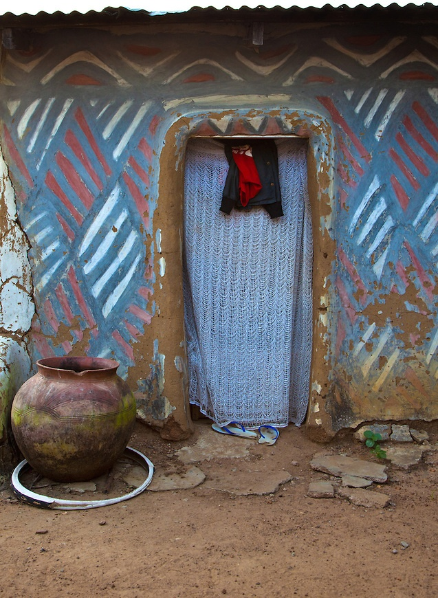 Door with Curtain and Hanging Shirt and Big Clay Pot, Adobe Building with Abstract Patterns in Sirigu Ghana by Myles Kwesi Hutchful