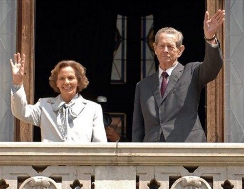 Former Romanian King Michael I, right, and his wife Ana, left, wave from the balcony of the Peles Castle, in Sinaia, Romania, which was officialy returned to the royal family Thursday June 5 2008. Michael I, who is 86, says his return to Peles Castle  a 160-room palace in the Carpathian Mountains rights a historic wrong. Michael was born on the estate and spent most of his childhood there. The palace was confiscated when the Communist regime forced him to abdicate in 1947.(AP Photo/Paul…
