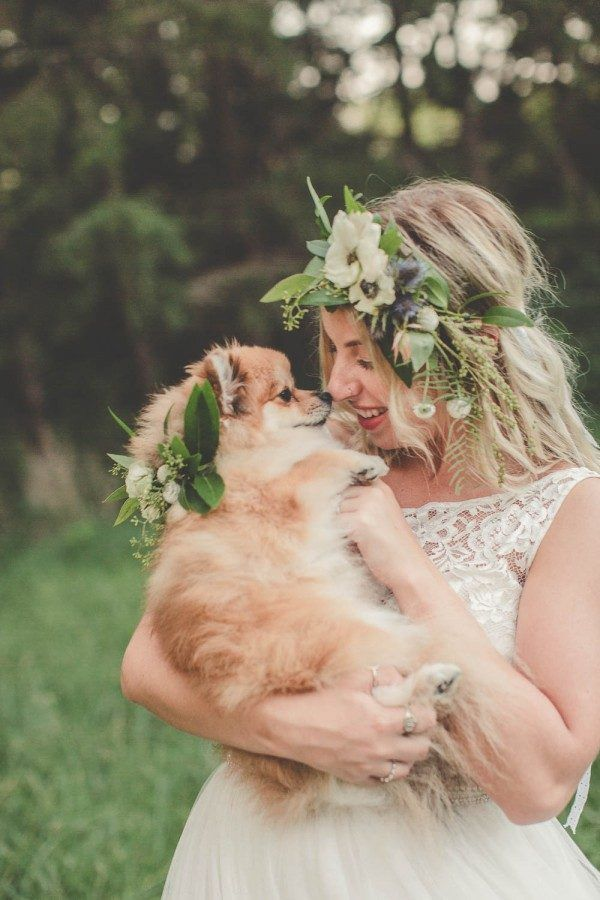 We can't stop smiling about the matching flower crowns worn by this boho bride and her Pomeranian | Image by Indium Photo