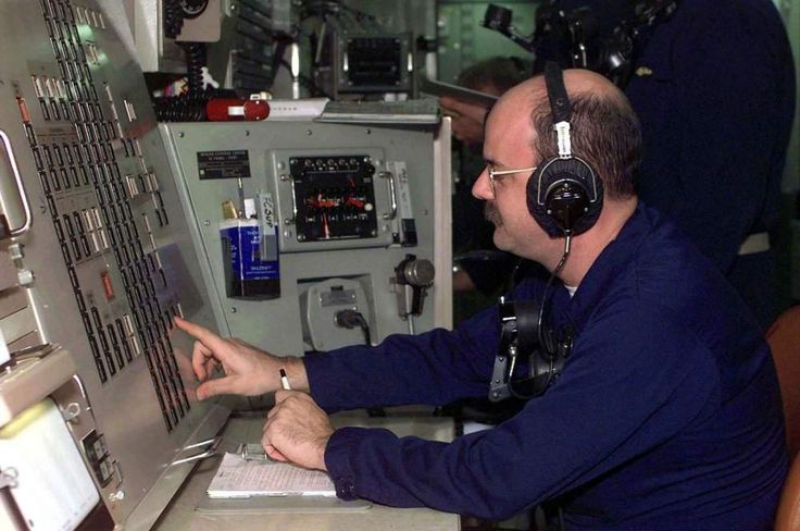 Missile Technician's 1st Class Mark Dorris performs duties as fire control supervisor during a Trident missile launch training drill on board the USS Rhode Island (SSBN-740) on 8 October 1996.