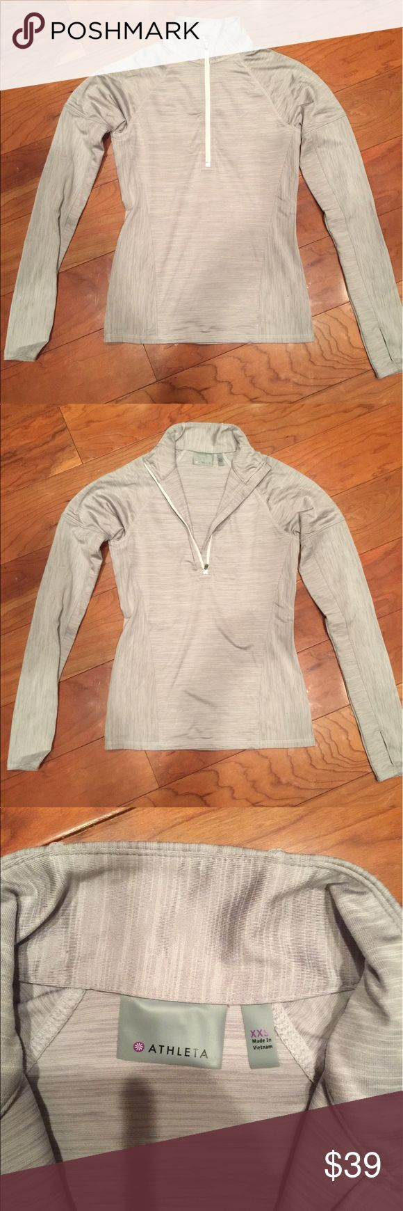 NEVER WORN Athleta grey pullover XXS lk Lululemon Lululemon style in a NEVER WORN Athleta XXS light grey pullover with a deep zipper and a back pocket zipper and thumb holes. NOT Lululemon. Just named for exposure lululemon athletica Tops Sweatshirts & Hoodies