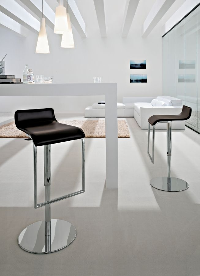Milano Tonin Casa  Swivelling stool with hydraulic mechanism and chromed metal base.  http://www.martinelstore.com/en/prod/chairs/stool/milano-tonin-casa.html