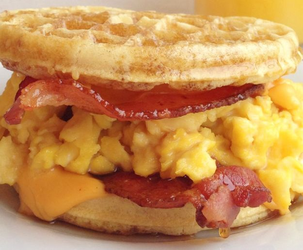 ultimate breakfast for dinner sandwich: bacon, egg, cheese & maple syrup on Eggo waffles