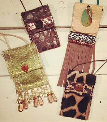 Pouch necklaces that I made from leather, fabric, ribbon, trim, beads and buttons.