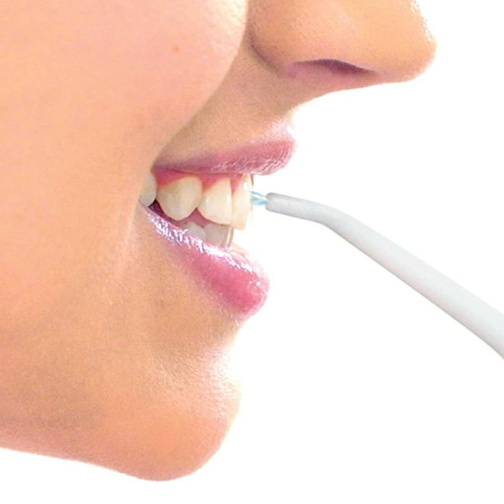 Dental flossing with an air-powered water jet