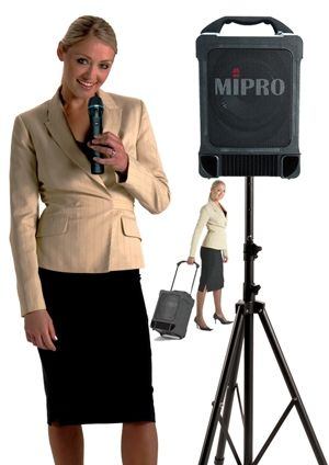 Mipro portable PA with choice of cordless microphones (Lapel, Headset, Hand-held). This can also play CDs and connect to iPod or laptop audio.