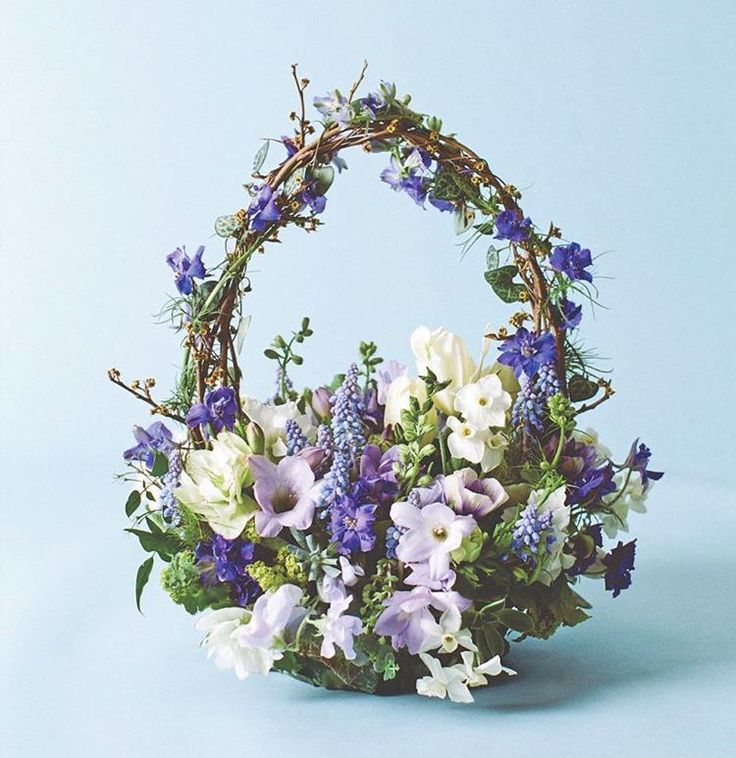 Portland, Oregon-based designer @francoiseweeks captures the magic of spring growth in this basket arrangement of witch hazel branches, rosary vine, tulips, anemones, sweet peas, paperwhites, muscari, hellebores, viburnum, alchemilla, freesia, succulents, cyclamen foliage, and larkspur. Photo: James Fitzgerald III #easter #easterbasket #flowers #spring  More basket arrangements at flowermag.com.