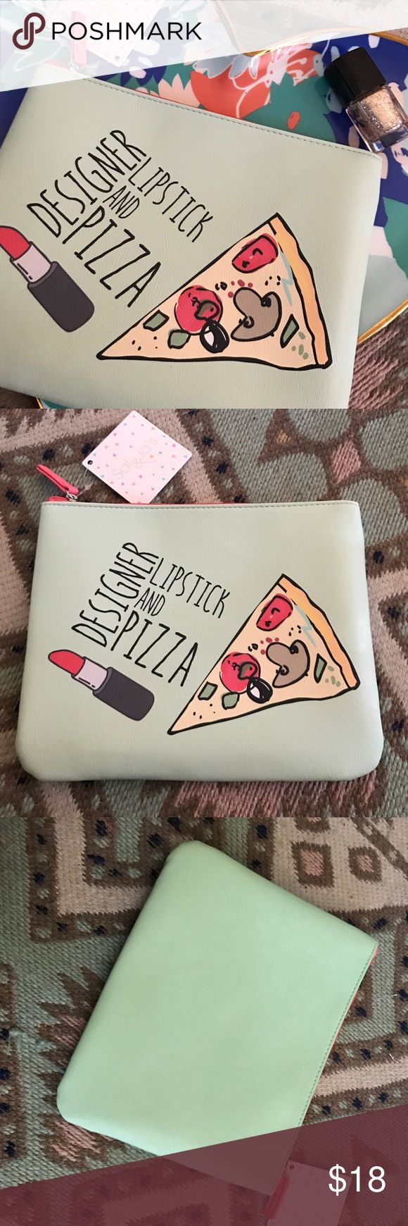 """""""DESIGNER LIPSTICK 💄 AND PIZZA 🍕"""" makeup bag New TRENDY """" DESIGNER LIPSTICK 💄 AND PIZZA 🍕"""" Makeup bag, with tags, 💝PERFECT GIFT FOR VALENTINE's DAY💕 RECEIVE 15% OFF when you BUNDLE 2 or more items.  MY CLOSET includes NEW and VINTAGE Vans, Nike, asics, Mostly NEW ITEMS some USED, WILL SHIP NEXT DAY. I accept reasonable offers Bags Cosmetic Bags & Cases"""