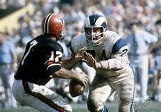 Merlin Olsen of the Rams chasing down Atlanta Falcons quarterback Bob Berry
