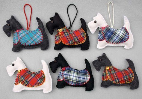 Handmade Scottie dog Christmas ornament. Dougal is a Scottish terrier made from dark charcoal grey felt, with a jolly buttoned jacket in teal or red cotton tartan, and a cotton loop for hanging. Please use the drop-down menu to choose teal or red jacket. He measures approx. 4 x 3.5 inches (10 x 9cm) You can see Dougals Scottie friends, shown in the last picture, and all my other dogs here; https://www.etsy.com/shop/PuffinPatchwork?ref=hdr_shop_menu§ion_id=17300721