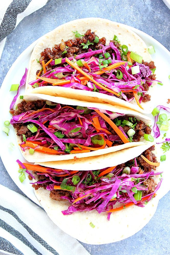 Korean Beef Tacos Ground Beef Caramelized In Sweet Soy Sauce Paired With Asian Slaw In Flour Tortillas Asi Korean Beef Beef Tacos Recipes Korean Beef Tacos