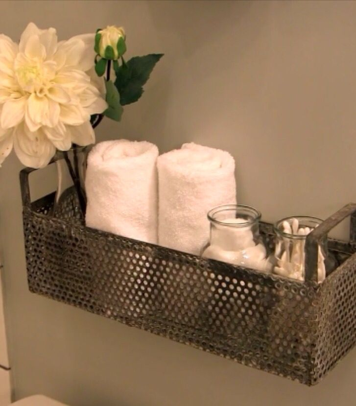 Basket for simple bathroom storage. From http://magnoliahomes.net