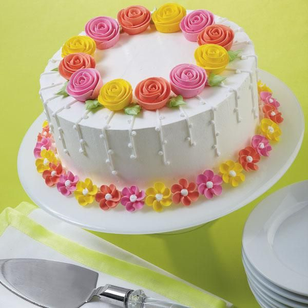 Fanciful Flowers Cake - Twisting flower styles in three dazzling colors make this cake a wonderful choice.
