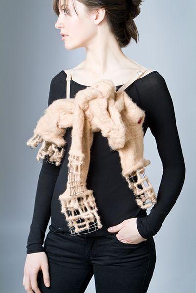 """Ritual Substitute,"" wool felt, steel, elastic, silver<br /> 18""x10""x5"", 2008"